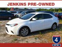 This 2014 Toyota Corolla LE, has a great White