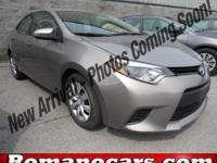 A 2014 toyota corolla with less than 35,000 miles on