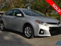 You're looking at a 2014 Toyota Corolla S Plus in