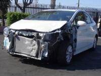 2014 Toyota Prius Plug-In that is damaged as shown