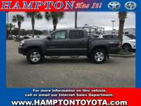 With less than 15,415 miles on this Toyota Tacoma,
