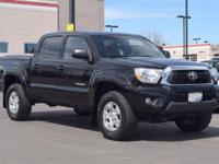 This 2014 Toyota Tacoma comes with Navigation, Gray