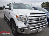 From city streets to back roads, this White 2014 Toyota
