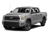 Tundra SR5, Automatic, and 4WD. Low miles mean barely