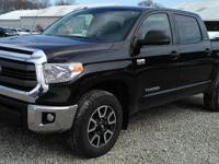 This one owner, 2014 Toyota Tundra has fog lights, a