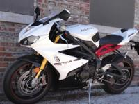 2014 Triumph Daytona 675R. This machine has 2040 miles