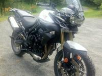This is a 2014 Triumph Tiger 800 'Roadie' w/ ABS, a