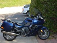This is a 2014 Pacific Blue Triumph Trophy SE touring