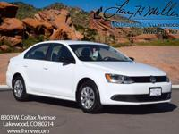 This Candy White 2014 Volkswagen Jetta S comes with