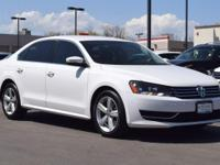 This 2014 Volkswagen Passat SE comes with Black