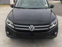 CARFAX 1-Owner, Volkswagen Certified. DEEP BLACK