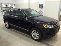 You are looking at a 2014 Volkswagen Touareg V6 that
