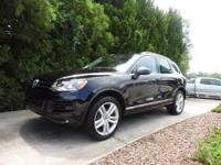 We are excited to offer this 2014 Volkswagen Touareg.