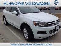This outstanding example of a 2014 Volkswagen Touareg