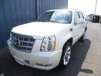 This outstanding example of a 2014 Cadillac Escalade