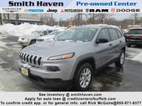 This outstanding example of a 2014 Jeep Cherokee Sport