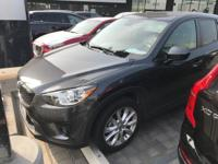 This 2014 Mazda CX-5 Grand Touring is proudly offered