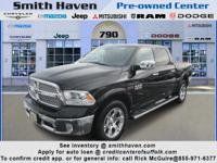 This outstanding example of a 2014 Ram 1500 Laramie is