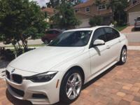 2015 BMW 328i xDRIVE Alpine White M package. Alpine