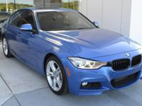 This 2015 BMW 335i Sedan is Estoril Blue Metallic with