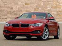 This 2015 BMW 4 Series 428i xDrive has AWD, Cold