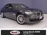 Step inside our Certified Pre-Owned BMW '15 Black 740i