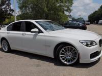 This 2015 BMW 7 Series 750i in Alpine White features: