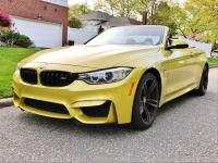 Up for sale is the Austin yellow convertible 2015 BMW