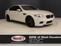 This 2015 BMW M5 is a One Owner vehicle, Alpine White