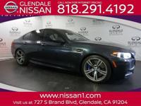 Check out this 2015 BMW M5 . Its Automatic transmission