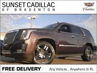 Escalade, with less than 11k miles, pretty much brand