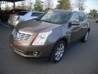 This outstanding example of a 2015 Cadillac SRX Premium