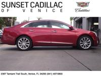 Crystal Red Cadillac XTS with Shale Interior. Features