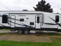 The 2015 Carbon 31 is a travel trailer toy hauler that