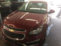 This 2015 Chevrolet Cruze in Maroon features. Front