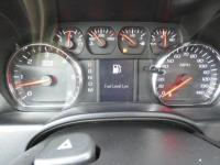 You win!!! Real gas sipper!!! 23 MPG Hwy!!! Less than