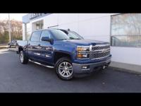 This 2015 Chevrolet Silverado 1500 LT features a hill