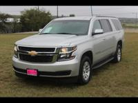 This SILVER 2015 Chevrolet Suburban LT 1500 might be