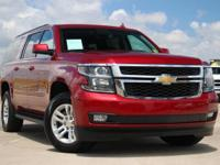 This outstanding example of a 2015 Chevrolet Suburban
