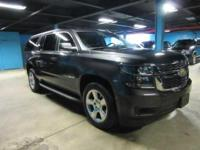 This certified pre-owned 2015 Suburban LT features gray
