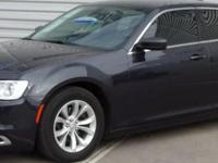 This outstanding example of a 2015 Chrysler 300 Limited