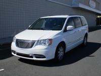 You are looking at a White, 2015 Chrysler Town and