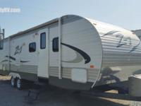The pre-enjoyed 2015 Cross Roads Z-1 Travel Trailer