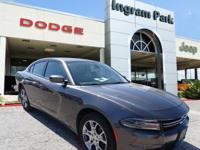 2015 Dodge Charger SE. This sedan offers a spacious