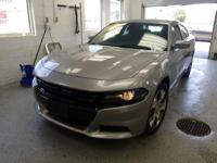 Recent Arrival! This 2015 Dodge Charger SXT in billet