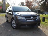 Our versatile 2015 Dodge Journey SE presented here in