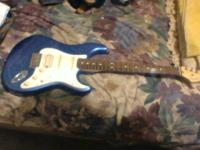 comes with fender hardshell case. custom shop pickups.