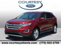This 2015 Ford Edge SEL in Ruby Red Metallic Tinted