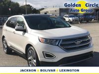 This is a White Platinum 2015 Ford Edge Titanium with