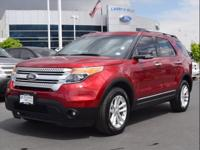 Exterior Color: red metallic, Body: AWD XLT 4dr SUV,